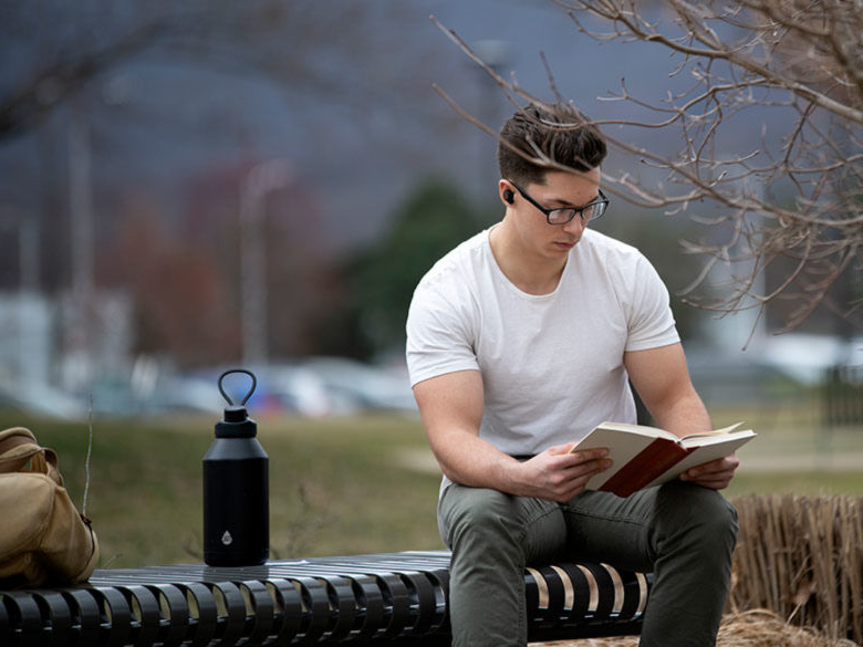 Student studying on campus.