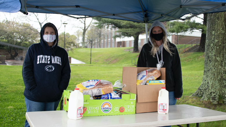 Amanda Collins, mental health counselor, and Ronette Poorbaugh, campus nurse, provide drive-thru donations from the campus food pantry to students in need.